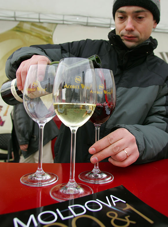 A Moldovan prepares wine glasses for tasting in central Bucharest.