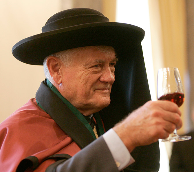 Lithuania's President Valdas Adamkus smiles during his appointment as a gentleman of the confraternity of Porto's wine.
