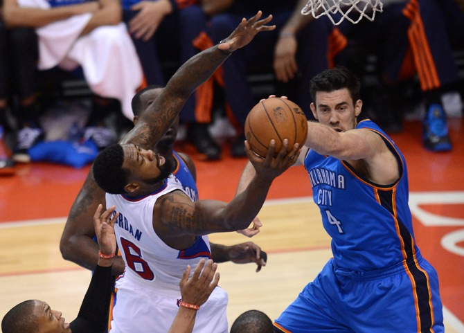 klahoma City Thunder forward Nick Collison (4) and Los Angeles Clippers center DeAndre Jordan (6) go for a rebound in the fourth quarter of game four of the second round of the 2014 NBA Playoffs at Staples Center. Clippers won 101-99.