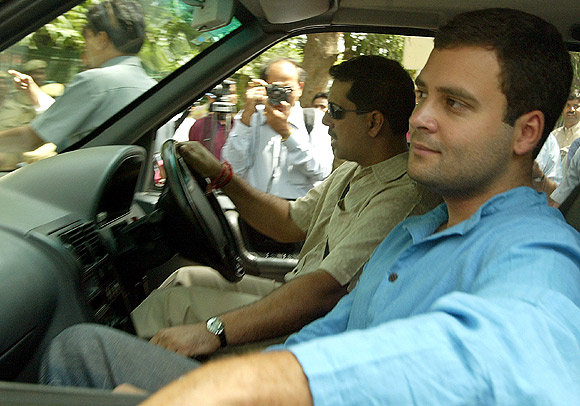 Rahul Gandhi accompanied by his brother-in-law Robert Vadra enters his house in New Delhi
