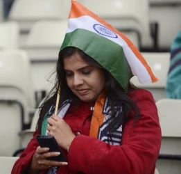 A woman wears the tricolour