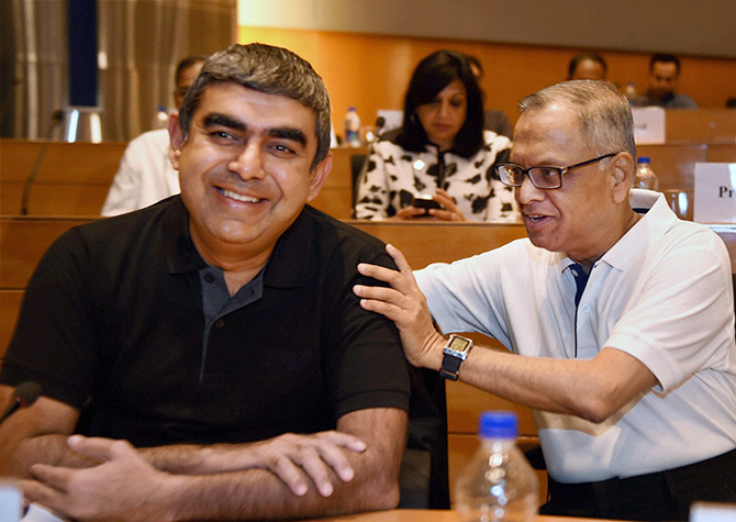 Then Infosys executive chairman N R Narayana Murthy with the newly appointed CEO & MD Vishal Sikka in Bengaluru, October 2014. Photograph: Shailendra Bhojak/PTI