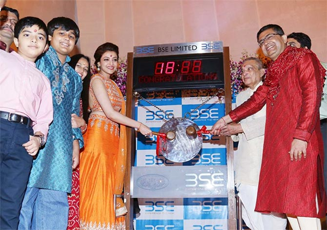 Image: Ashish Chauhan, CEO of the Bombay Stock Exchange with Kajal Agarwal during the Muhurat Trading session. Photograph, courtesy: BSE.