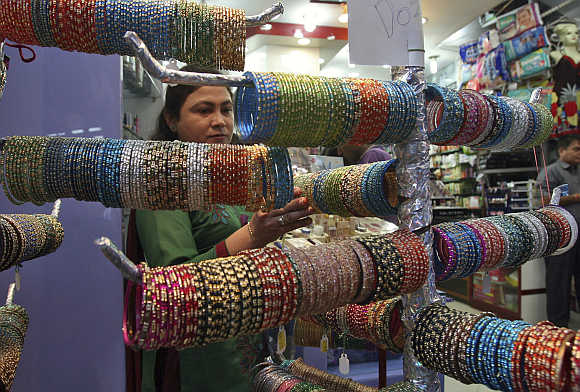 A woman buys bangles in Jammu.