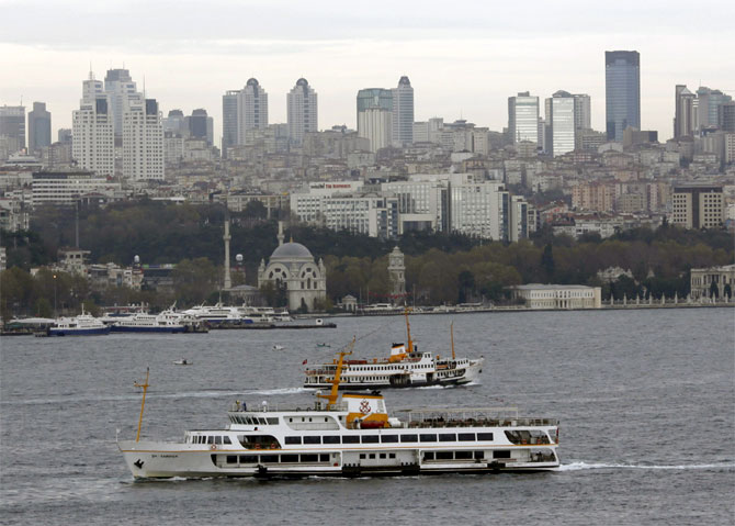 Ferries transport people between European and Asian sides of the city in Istanbul.