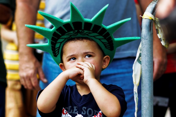 A child attends a ceremony to reopen the Statue of Liberty and Liberty Island to the public in New York July 4, 2013.