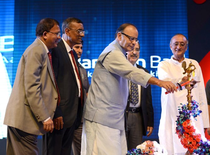 Arun Jaitley lights the ceremonial lamp as RBI Deputy Governor H R Khan (extreme left), Chandra Shekhar Ghosh (middle) and West Bengal Finance Minister Amit Mitra (right) look on.