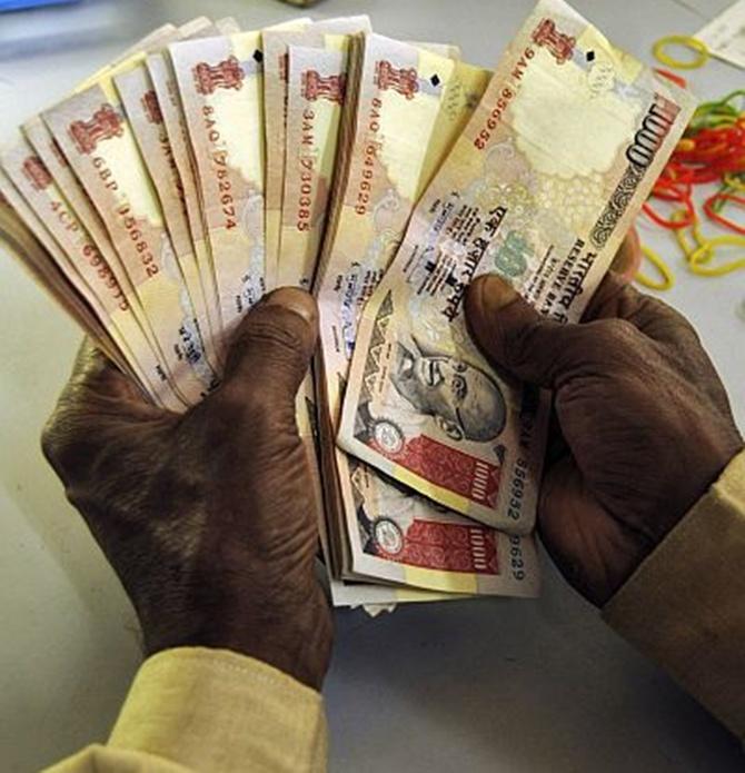 Rupee falls 11 paise to 66.44 vs US dollar