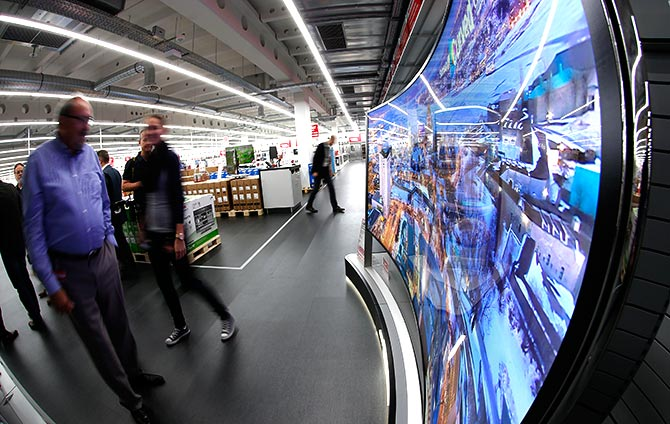 People watch a curved LED television