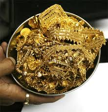 Gold loses sheen on muted demand, silver also eases