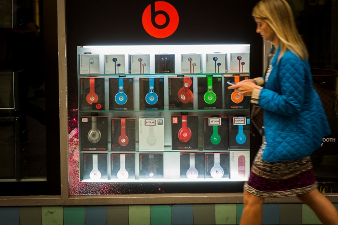 A pedestrian walks past a Beats brand display in the subway system of New York. Lucas Jackson/Reuters