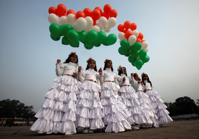 School children holding tri-coloured balloons take part in the Republic Day celebrations in Chandigarh.
