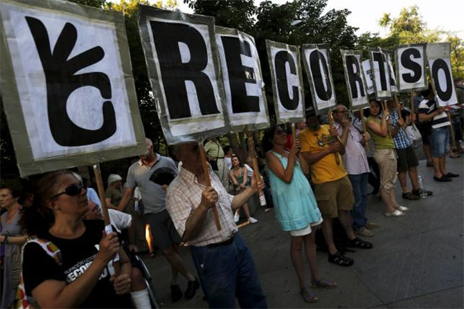People hold letters that make up the sentence 'Zero cuts', during a demonstration in support of Greece in central Madrid, Spain.