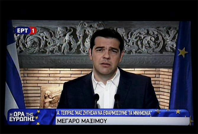 Image: Greek Prime Minister Alexis Tsipras is seen on a television monitor while addressing the nation. Photograph: Reuters