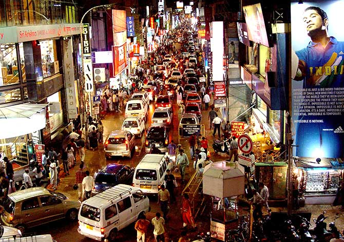 Commuters are seen on a busy commercial street in the southern Indian city of Bengaluru