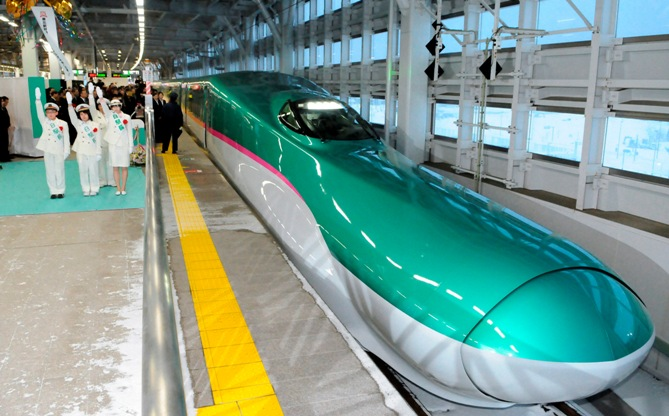 The Hayabusa shinkansen or bullet train departs from Aomori station in Aomori, northern Japan. Photograph: Kyodo/Reuters