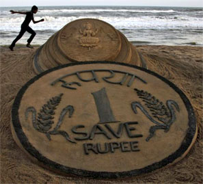 Rupee closes marginally lower by 2 paise at 63.82