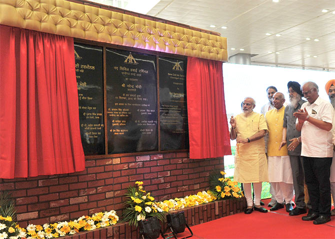 Prime Minister Narendra Modi inaugurates the New Civil Air Terminal, at Chandigarh airport on September 11, 2015. Governor of Punjab and Haryana and Administrator, Union Territory, Chandigarh, Professor Kaptan Singh Solanki, Chief Minister of Punjab Prakash Singh Badal, Chief Minister of Haryana Manohar Lal Khattar, Union Minister for Civil Aviation Ashok Gajapathi Raju Pusapati and other dignitaries are also seen.