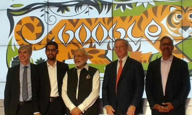 Prime Minister Narendra Modi at the Google headquarters, flanked by Google CEO Sunder Pichai and former Google CEO Eric Schmidt. On the right is early Google investor Ram Shriram, and on the left, Google co-founder and Chairman Larry Page.