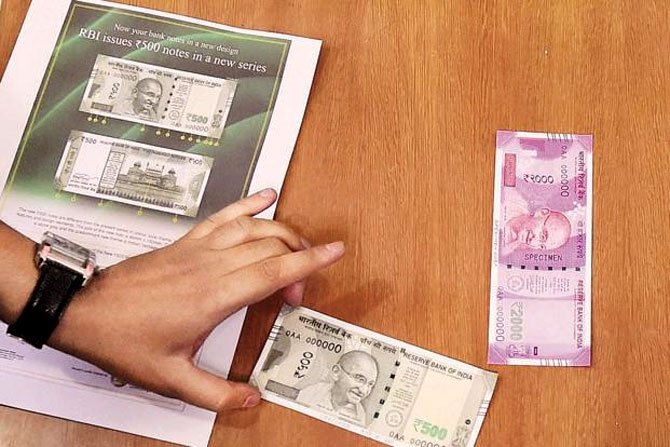 When did printing of Rs 2,000 notes actually begin? - Rediff