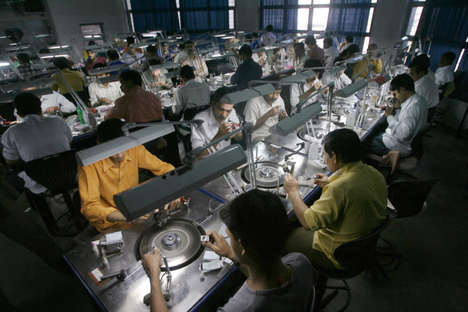 Employees at a diamond cutting and polishing factory in Surat