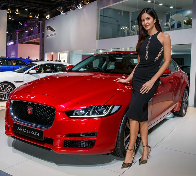 Actress Katrina Kaif poses with a Jaguar car