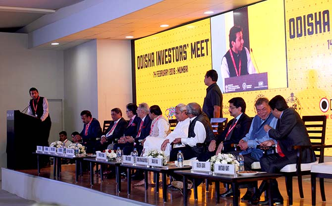 Ritesh Agarwal (extreme left), founder, OYO Rooms, speaks about his vision for Odisha's start ups as T V Narendran (third), Managing Director, Tata Steel, Y C Deveshwar (fifth), Chairman, ITC, Naveen Patnaik, Odisha chief minister (centre), Bibek Debroy, economist and member, NITI Aayog, Kumarmangalam Birla, Chairman, Aditya Birla Group, Shashi Ruia of Essar Group listen to his speech.