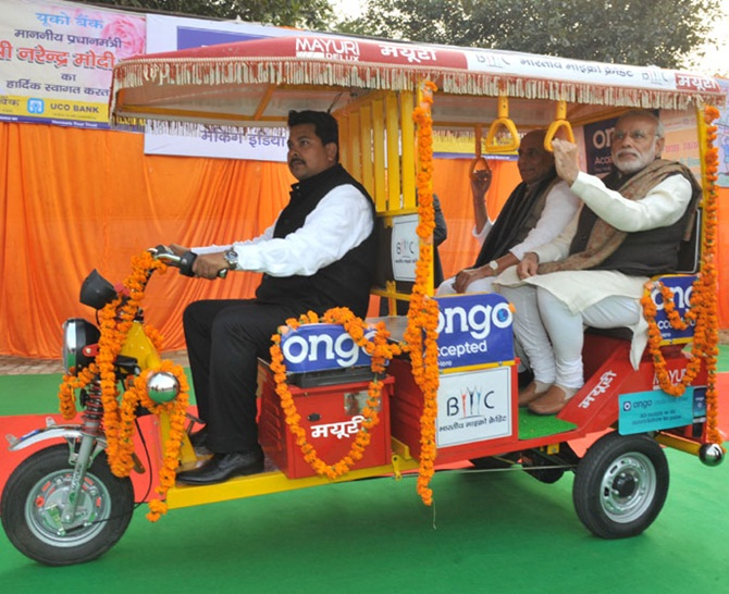 Prime Minister Narendra Modi takes a ride in an E-Rickshaw in Lucknow, January 22, 2015. Photograph: Press Information Bureau
