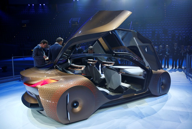 People look at the BMW 'Vision Next 100' concept car