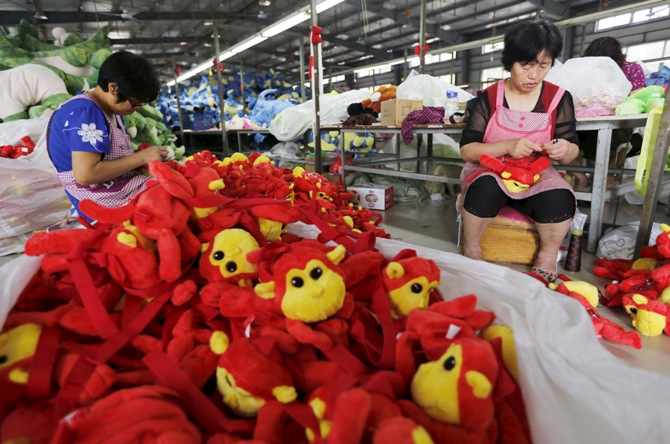 Workers make stuffed dolls which are to exported to Europe and north America, at a factory in Lianyungang, Jiangsu province, China.