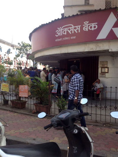 IN PIX: People throng banks as they reopen on Thursday