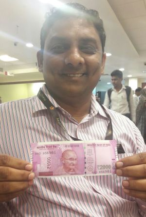 Posing with new Indian currency