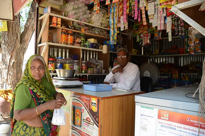 Neeruba is a regular customer at Jayantibhai's. While she doesn't understand technology too much and hesitates using her phone to make digital payments, Jayantibhai knows her son will make the payment whenever he comes by his shop