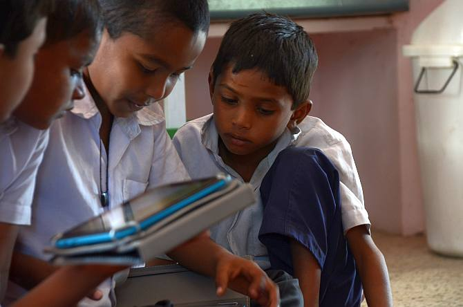 Jyotsnaben Patel's wards enjoy studying simple concepts on their tablets