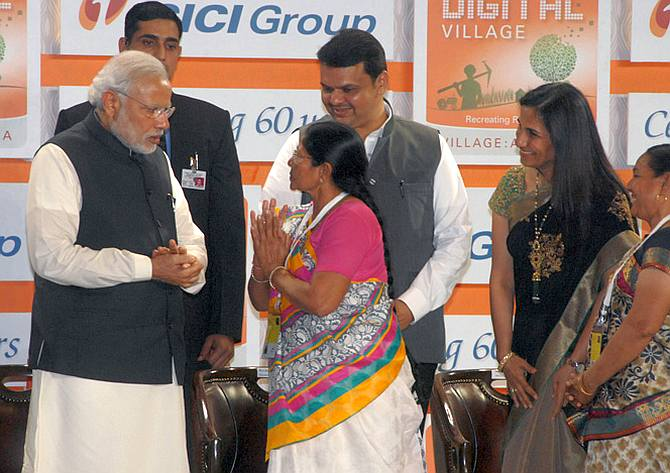 Prime Minister Narendra D Modi dedicated ICICI Bank's Digital Village to the nation, January 2, 2015. To Modi's left is Maharashtra Chief Minister Devendra Fadnavis and ICICI Bank MD and CEO Chanda Kochhar. Photograph: Kind courtesy narendramodi.in