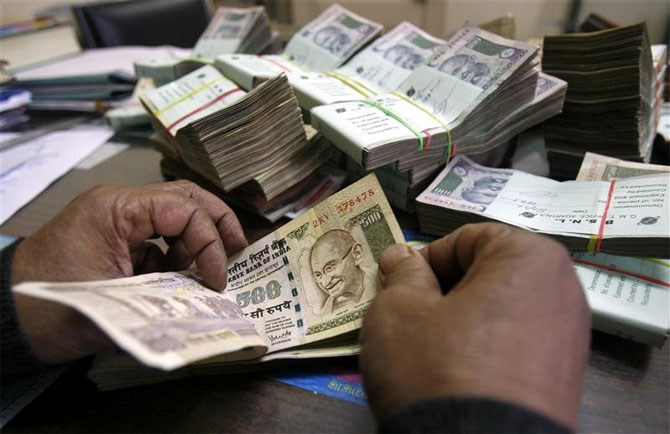 Rupee wobbles on resurgent dollar, falls 17 paise to 66.88