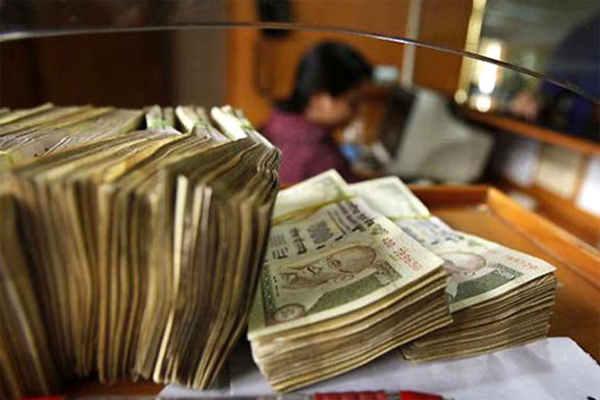 Rupee firms up against soft dollar, up 5 paise at 66.68