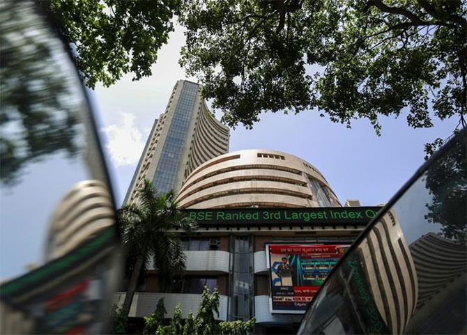 Sensex back in red, down 105 points as banks weigh