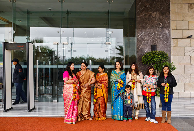 Guests hold marigold garlands to receive their relatives outside the Holiday Inn, run by the InterContinental Hotels Group, New Delhi. Photo: Anindito Mukherjee/Reuters