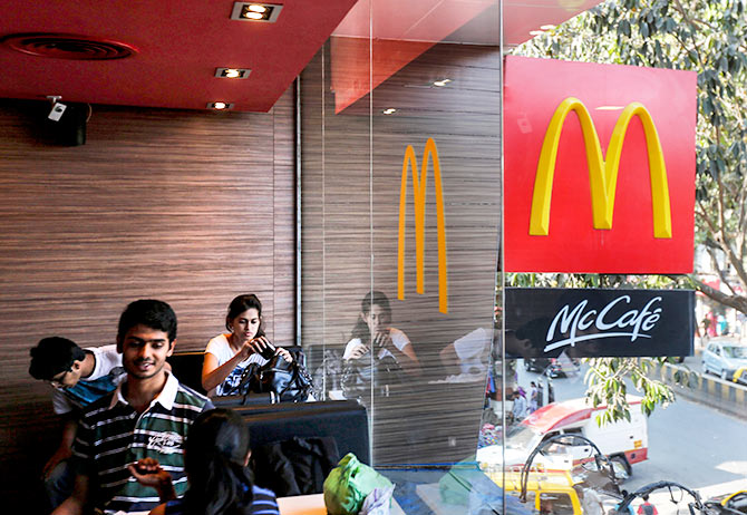 Visitors are seen at a McDonald's restaurant in Mumbai February 10, 2015. Photo: Shailesh Andrade/Reuters