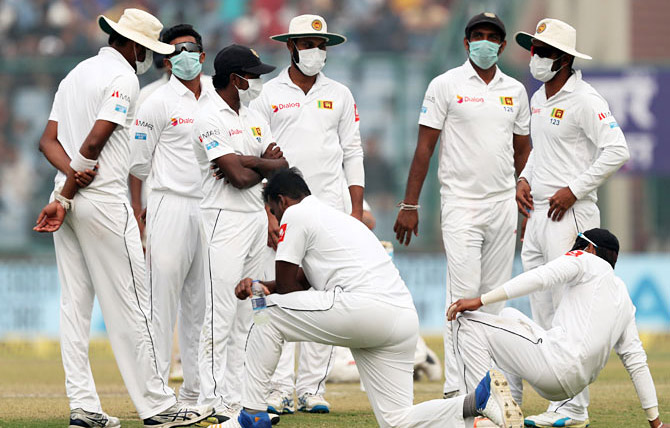 Sri Lankan cricketers wear masks during a recent match in Delhi