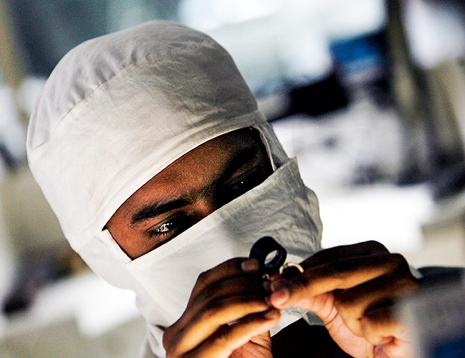 An employee at a diamond cutting and polishing factory in Surat, Gujarat. Photograph: Arko Datta/Reuters
