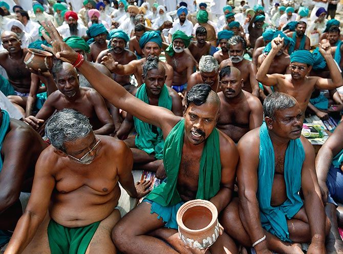 Farmers from Tamil Nadu pose half shaved during a protest demanding a drought-relief package from the Union government, in New Delhi, April 3, 2017. Photograph: Cathal McNaughton/Reuters