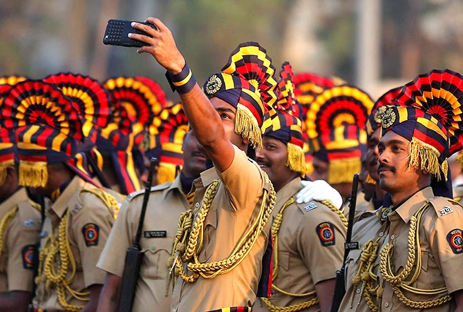 Policemen in ceremonial attire take a selfie photo before the start of a full-dress rehearsal for the Republic Day parade, Mumbai, India January 24, 2017. Photo: Shailesh Andrade/Reuters