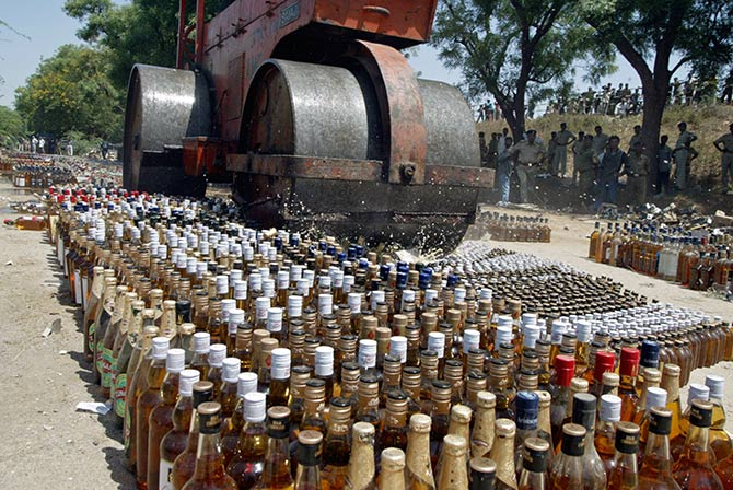 A roller crushes liquor bottles at Koba village, about 18 km (12 miles) north from the western Indian city of Ahmedabad March 28, 2006. The state prohibition department of western Indian state of Gujarat disposed of 22,000 seized bottles of liquor, an official said on Tuesday. Photo: Amit Dave/Reuters