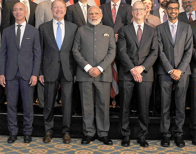 Prime Minister Narendra D Modi is flanked by Jeff Bezos of Amazon, John Chambers of Cisco, Tim Cook of Apple and Sunder Pichai of Google, Washington, DC, June 25, 2017. Photograph: Press Information Bureau