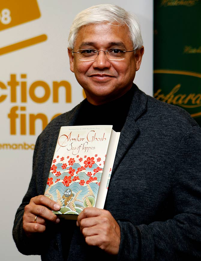 Man Booker Prize shortlist nominee Indian author Amitav Ghosh poses with his book Sea of Poppies ahead of the announcement of the winner in central London, October 14, 2008. Photo: Stephen Hird/Reuters