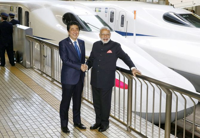 Modi and Abe pose in front of a Shinkansen bullet train. Photograph: Kyodo/via Reuters