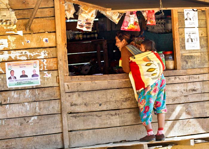 A woman buys food from a shop in Meelen village, south of the northeastern city of Imphal January 23, 2012. Photo: Rupak De Chowdhuri/Reuters