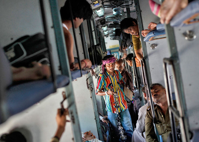 A man sells locks and chains inside a compartment of the Kalka Mail passenger train on the way to Kolkata March 20, 2012. Photo: Danish Siddiqui/Reuters